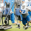 Don Knight | The Herald Bulletin<br /> From left, Jack Mewhort and Jonotthan Harrison hit a sled during Colts practice on Saturday.
