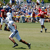 Wide receiver Quan Cosby makes his cut as Andrew Luck lets the football fly during passing drills.