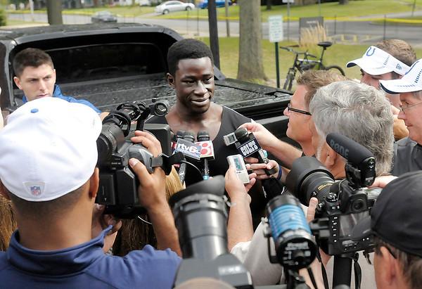 Don Knight/The Herald Bulletin<br /> Daniel Adongo talks to the media.