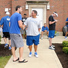 Don Knight/The Herald Bulletin<br /> Andrew Luck greets quarterback coach Clyde Christensen.