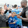 Don Knight | The Herald Bulletin<br /> Outside linebacker Robert Mathis gives a fan her phone back after autographing it after practice during Colts Camp at AU on Tuesday.