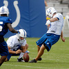 Pat McAfee kicks field goals during drills.