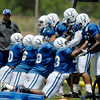 Colts defensive linemen go through drills.
