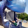 Jacob Eccles, 15, from Westfield, tumbles out the horses mouth, a giant colt head inflatable, in the kids zone at Colts City Tuesday.
