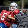 Colts quarterback Chandler Harnish gets squeezed as he goes through drills.