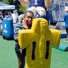 Aaliyah Hardy, 12, of Anderson, gets her hands up, just like the giant Colt in the background, to hit the tackling dummy as she goes through the NFL Play 60 drill at Colts City Tuesday.