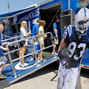 A life-size poster of Dwight Freeney greets people as they go into the Colts interactive trailer at Colts City.