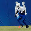 Colts wide receiver Reggie Wayne runs through drills.