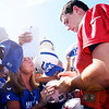 Andrew Luck signs autographs after the Colts practice at AU on Sunday.