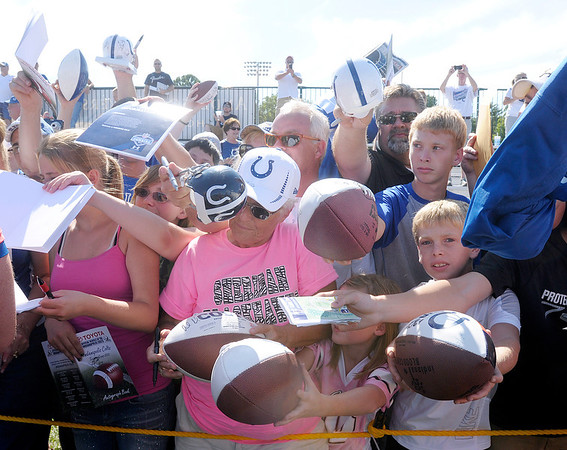 Fans wait for autographs after the Colts' practice at Anderson University on Sunday.