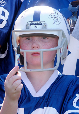 Raiden Hartman, 7, from Logansport waits for Andrew Luck to autograph his helmet after the Colts practice at AU on Sunday.