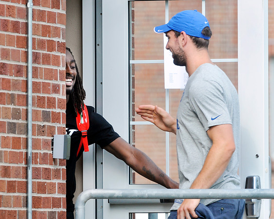 John P. Cleary | The Herald Bulletin<br /> Colts WR T.Y. Hilton holds the door for QB Andrew Luck as they enter the players dorm at training camp.