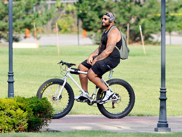 John P. Cleary | The Herald Bulletin<br /> Colts guard Hugh Thornton rides his bike through the AU campus as he heads toward the players dorm after reporting to training camp.
