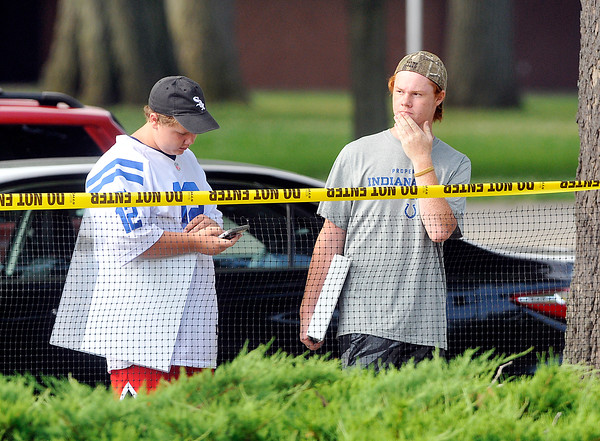 John P. Cleary   The Herald Bulletin<br /> A few Colts fans try to get a glimpse of any players as they reported Tuesday morning to training camp.