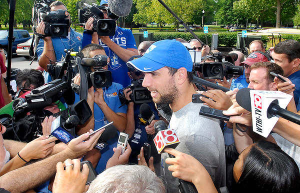 John P. Cleary   The Herald Bulletin<br /> Colts QB Andrew Luck talks with the media after arriving at training camp.