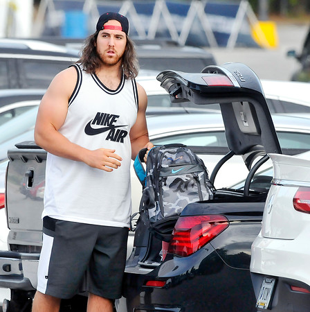 John P. Cleary | The Herald Bulletin<br /> Colts Anthony Castonzo  starts to unpack his car after arriving to AU for training camp.