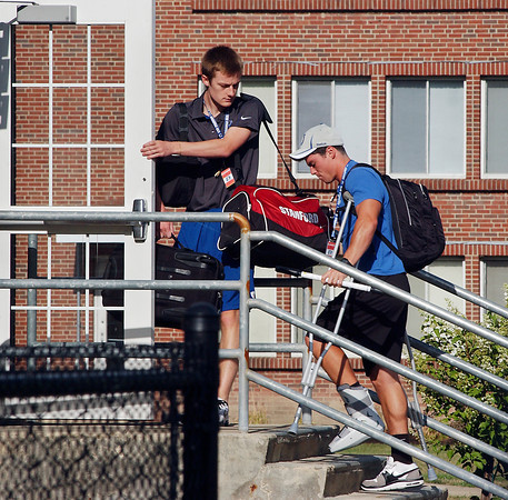 Colt rookie tight end Griff Whalen gets help getting into the players' dorm at AU after reporting for training camp Saturday.