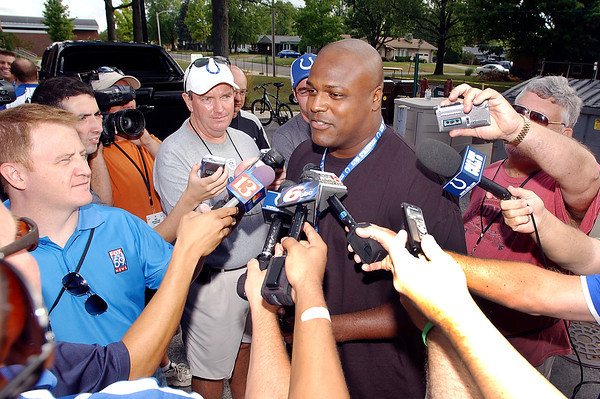 Defensive end Cory Redding talks to the media after reporting to Colts training camp Saturday.