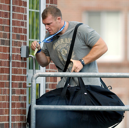 Colts long snapper Matt Overton goes into the players dorm after reporting to training camp.