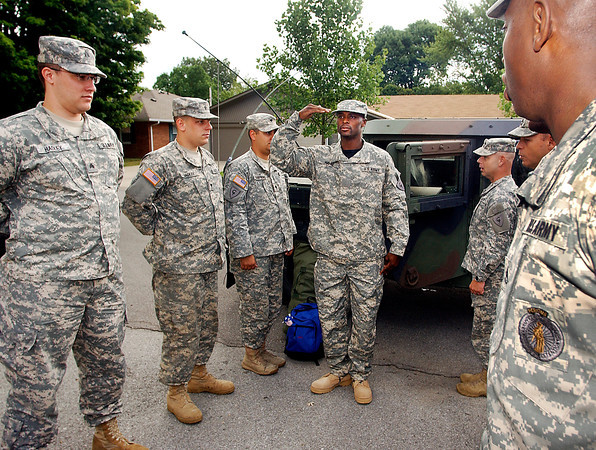 """Indianapolis Colts wide receiver Reggie Wayne """"reported for duty""""  to Colts training camp escorted by the 38th Aviation Brigade Recruiting Command from Shelbyville dressed in full military fatigues and arriving in Humvees."""