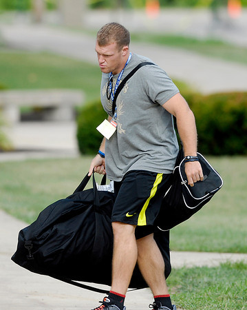 Colts long snapper Matt Overton carries his bags to the players dorm after reporting to training camp.