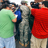 Indianapolis Colts wide receiver Reggie Wayne stands out in his military fatigues talking to the media after reporting to training camp escorted by the 38th Aviation Brigade Recruiting Command from Shelbyville  arriving in Humvees.