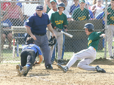 Midview North catcher Zachery Wilson dives toward home plate with the ball to tag out Columbia's Brandon Severo.  photo by Chuck Humel
