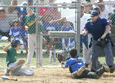 Midview North catcher Zachery Wilson dives toward home plate with the ball to tag out Columbia's Brandon Severo. A Columbia coach, background, makes a wishfull call.   photo by Chuck Humel