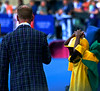 Alan Burnett about to start the Athletics session with the help of a little Jamaican boy