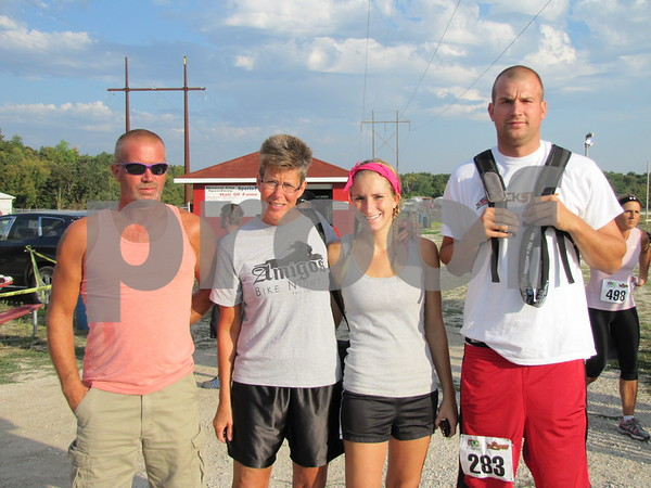 Scott, Debbie, Nicole, and Danny Licht before the mud run.  Debbie was there to take pictures of her family.