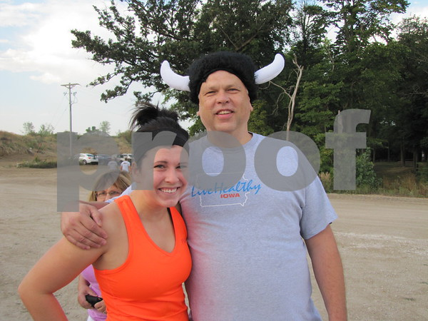 Father/daughter team of Michelle and Doug Willett before they register for the REC sponsored Mudzilla 5K obstacle course at Mineral City Speedway south of Fort Dodge.