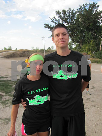Mya and Chad Lee before taking off on the obstacle course 5K run at Mineral City Speedway.