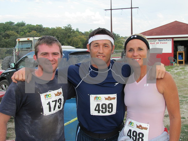 Ben Duncker with friends, Troy and Shawn Bennett before the three take off on the 5K run/obstacle course, the Mudzilla Mud Run sponsored by the Fort Dodge REC.