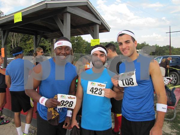 Charles Moduolu, Evan Thomas, and Joey Ammouri before the mud run.