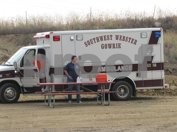 Ambulance service stands by should they be needed at the Mudzilla 5K run/obstacle course at Mineral City Speedway.