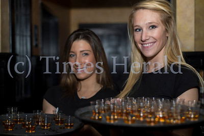 PJ Whelihan's waitresses of the Blue Bell establishment pose with complementary shots of Fireball Whiskey during a qualifying round of the Wing Bowl 22 eating competition. Rick Kauffman/Times Herald Staff