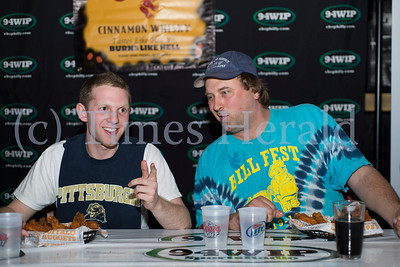 "Danny ""The Tickler"" Besticker, left, and Bill ""Do It Now Daddy"" Garges, right, went head-to-head in the overtime round of the wing eating competition at PJ Whelihan's in Blue Bell. Garges won the eat-off and earned an opportunity to compete at the final qualifying round in Downingtown.  Rick Kauffman/Times Herald Staff"