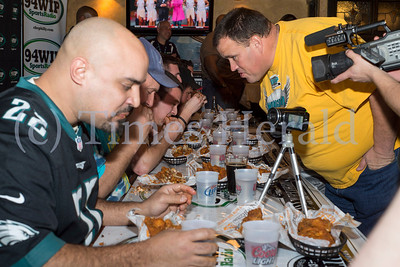 Wing Bowl-hopefuls line up and choke down wings at the PJ Whelihan's in Blue Bell to vie for an opportunity to compete in the Wing Bowl 22 at the Wells Fargo Ceenter.  Rick Kauffman/Times Herald Staff