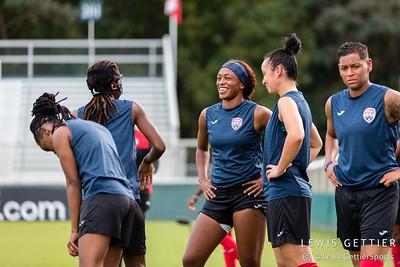 Trinidad & Tobago defender Liana Hinds (9) and Trinidad & Tobago defender Arin King (5)