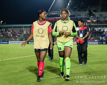 Trinidad & Tobago defender Cecily Stoute (16) and Trinidad & Tobago goalkeeper Saundra Baron (20)