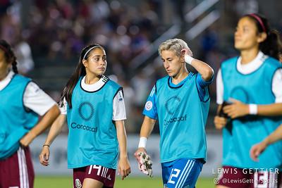 Mexico defender Arianna Romero (14) and Mexico goalkeeper Bianca Henninger (12)