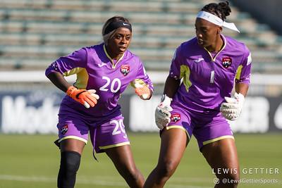 Trinidad & Tobago goalkeeper Saundra Baron (20) and Trinidad & Tobago goalkeeper Kimika Forbes (1)