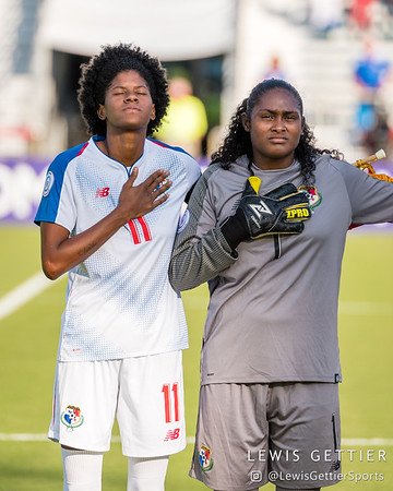 Panama forward Natalia Mills (11) and Panama goalkeeper Yenith Bailey (1)