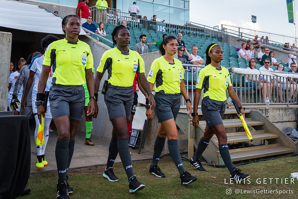 Assistant referee Princess Brown, Center referee Odette Hamilton, Fourth official Mirian Leon, and Assistant referee Stephanie-Dale Yee Sing