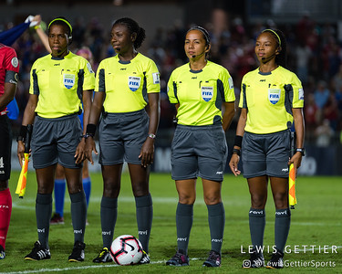 Assistant referee Princess Brown, Center referee Odette Hamilton, Fourth official Tatiana Guzman, and Assistant referee Stephanie-Dale Yee Sing