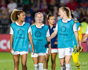United States defender Casey Short (14), United States defender Hailie Mace (12), and United States midfielder Samantha Mewis (3)