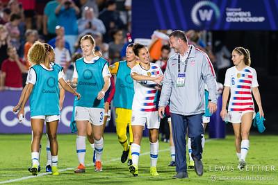 United States defender Casey Short (14), United States midfielder Samantha Mewis (3) and United States forward Carli Lloyd (10)