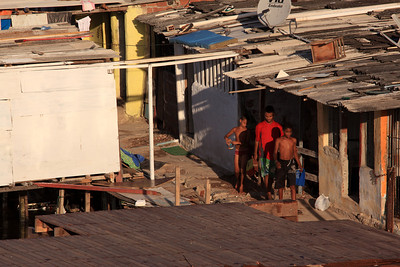 A riverside shantytown in Recife, Pernambuco state, Brazil, Jan. 9, 2013. While there is a massive housing deficit in the area, and in Brazil as a whole, construction of a stadium nearby, which will be used for the Confederations cup in June 2013 and the World Cup in 2014, continues at an accelerated pace. (Australfoto/Douglas Engle)