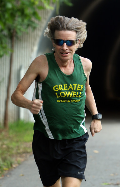 JUly 21, 2021 -- Regular runner Jim Rhoades of Lowell, on the start of the Bruce Freeman Trail at Cross Point.  SUN/Julia Malakie