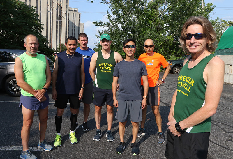 July 21, 2021 -- Regular runner Jim Rhoades of Lowell, right, with running friends, from left, Jim Quadros of Lowell, Luis Rios of Lowell, Eric Beauchesne of Chelmsford, Frank Georges of Lowell, Tony Ly of Lowell, and Colin Loghin of Westford, on the start of the Bruce Freeman Trail at Cross Point.  SUN/Julia Malakie